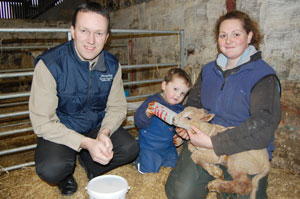 Elizabeth McAllister and her son James administering Provita Lamb Colostrum to a newborn Charollais lamb. The birth took place during a visit made by Provita's Tommy Armstrong (also pictured) earlier this week. Every lamb born on the McAllister farm receives the colostrum within 15 to 20 minutes of birth.
